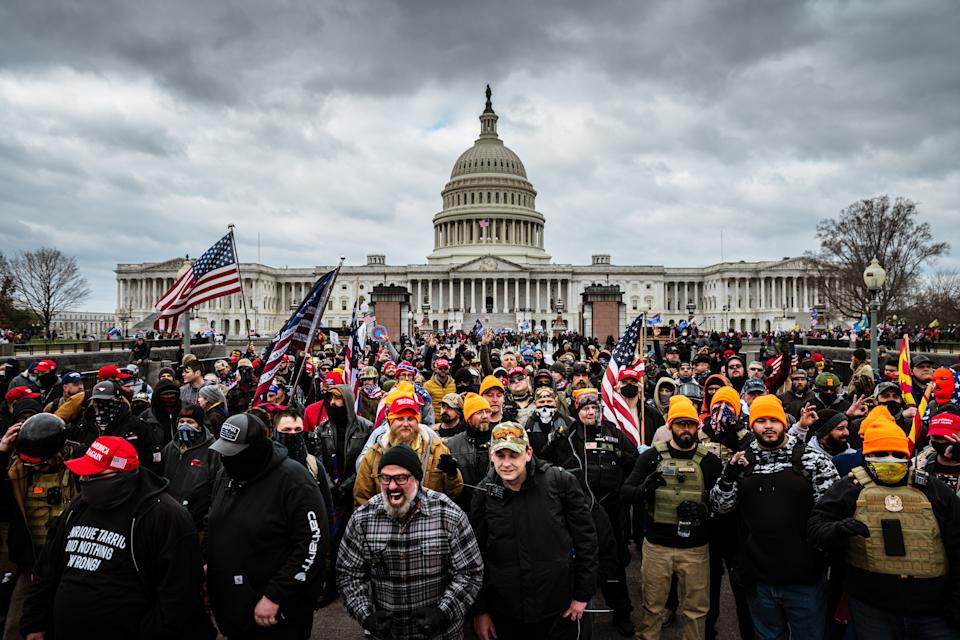 Protesters gather in front of the U.S. Capitol Building where a pro-Trump mob stormed the Capitol, breaking windows and clashing with police officers. (Photo by Jon Cherry/Getty Images)