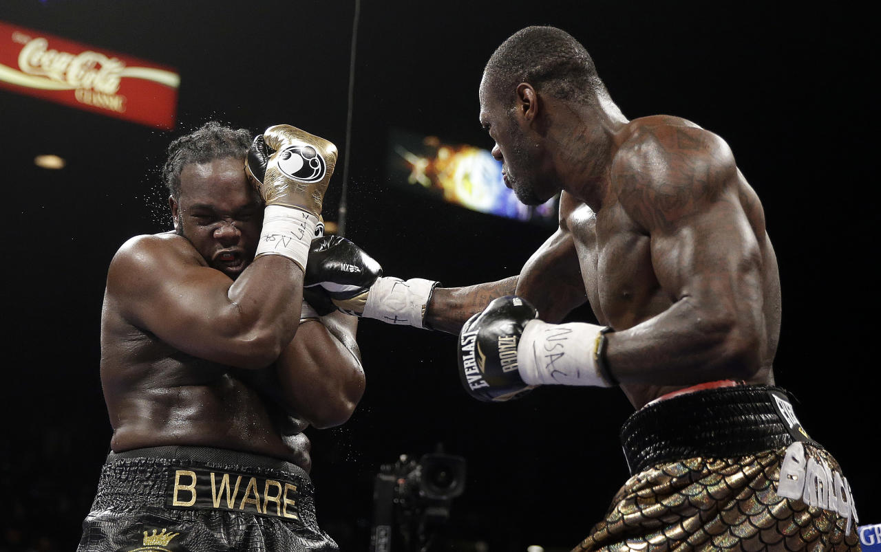 Deontay Wilder, right, punches Bermane Stiverne during their WBC heavyweight championship boxing match Saturday, Jan. 17, 2015, in Las Vegas. (AP Photo/Isaac Brekken)