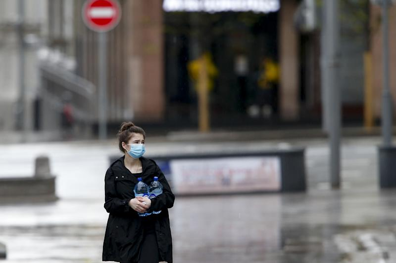 MOSCOW, RUSSIA - MAY 5: A woman wearing a mask walks at a Kamergerskiy Pereulok, remaning nearly empty due to the lockdown as a measure against the coronavirus (COVID-19) pandemic in Moscow, Russia on May 5, 2020. Russia on Tuesday confirmed 10,102 new cases of the novel coronavirus, bringing the total number to 155,370. he death toll in the country rose to 1,451, as 95 more people lost their lives over the past 24 hours, according to the Russian emergency team. The total number of recoveries reached 19,865, while 222,500 people remain under medical surveillance, it added. (Photo by Sefa Karacan/Anadolu Agency via Getty Images)