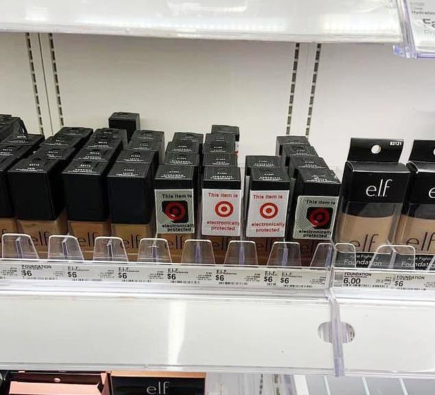 Image of foundation on Target shelf. Black/ darker shade security tagged, fair/ white shades left open