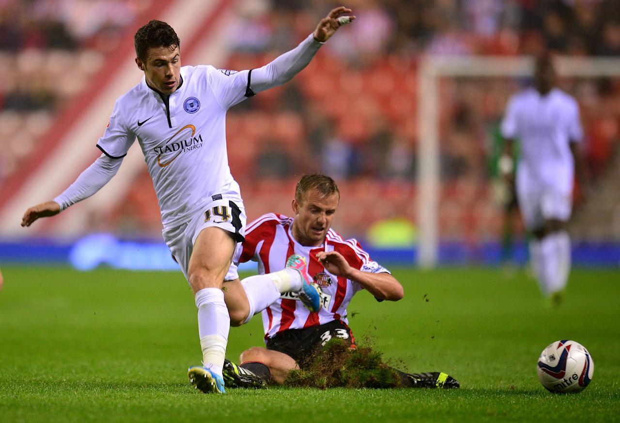 Sunderland's Lee Catermole (right) challenges on Peterborough United's Tommy Rowe during the Capital One Cup, Third round match at the Stadium of Light, Sunderland.