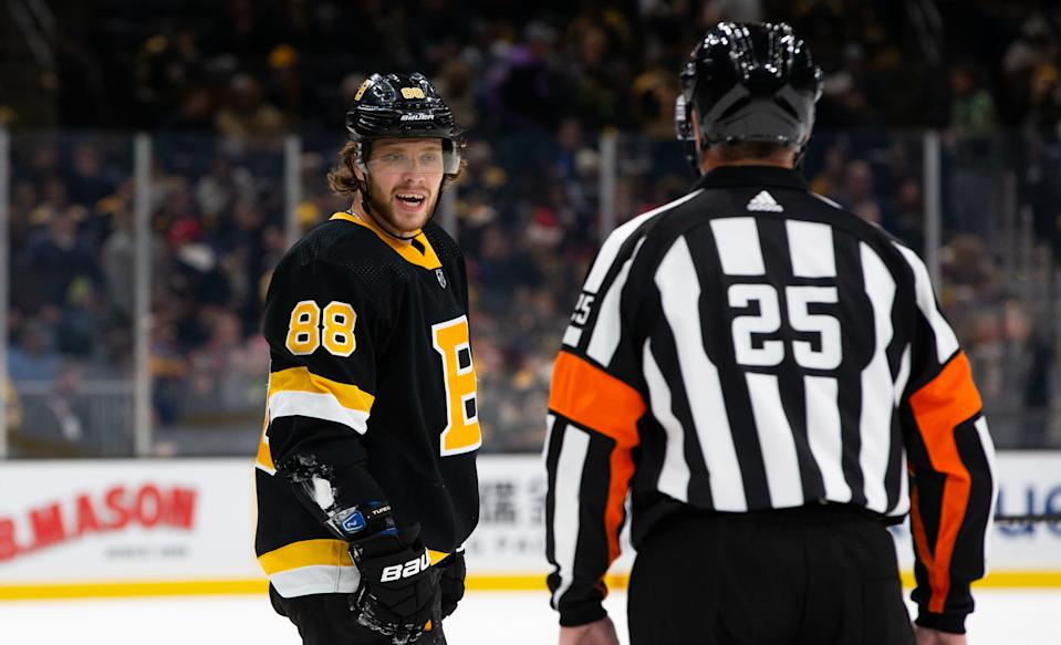 BOSTON, MA - DECEMBER 21: David Pastrnak #88 of the Boston Bruins talks to an official during a game against the Nashville Predators at TD Garden  on December 21, 2019 in Boston, Massachusetts. (Photo by Rich Gagnon/Getty Images)