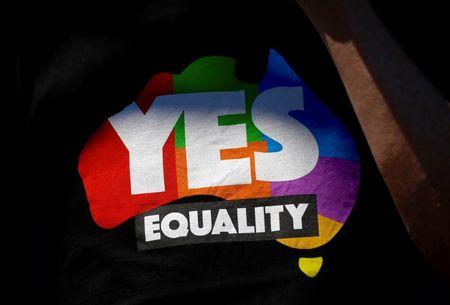 A supporter of the 'Yes' vote for marriage equality wears a shirt as he celebrates after it was announced the majority of Australians support same-sex marriage in a national survey, at a rally in Sydney