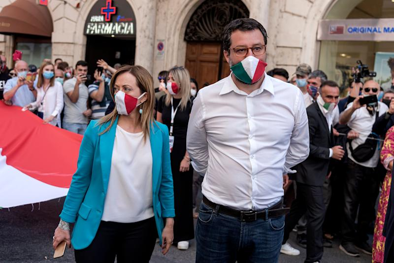 ROME, ITALY - JUNE 02: Fratelli d'Italia leader Giorgia Meloni (L) and Lega leader Matteo Salvini (R) attend a demonstration against the Italian government as phase two of the lifting lockdown exit plan continue on June 02, 2020 in Rome, Italy. The protest organised by the Lega political party, Fratelli d'Italia and Forza Italia is to voice concerns about the economic problems related to the coronavirus pandemic. (Photo by Stefano Montesi - Corbis/ Getty Images) (Photo: Stefano Montesi - Corbis via Getty Images)