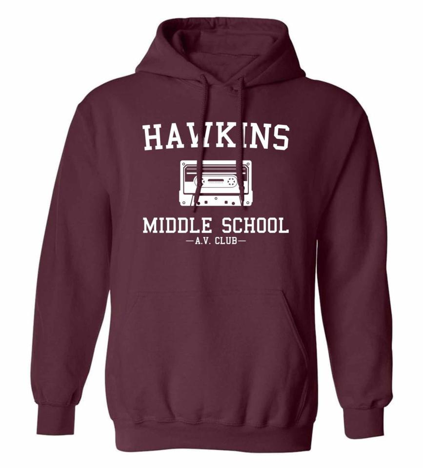 """<p>This <product href=""""https://www.etsy.com/listing/772222969/hawkins-middle-school-av-club-hoodie"""" target=""""_blank"""" class=""""ga-track"""" data-ga-category=""""internal click"""" data-ga-label=""""https://www.etsy.com/listing/772222969/hawkins-middle-school-av-club-hoodie"""" data-ga-action=""""body text link"""">Hawkins Hoodie</product> ($30) will keep them warm when they watch <strong><a class=""""sugar-inline-link ga-track"""" title=""""Latest photos and news for Stranger Things"""" href=""""https://www.popsugar.com/Stranger-Things"""" target=""""_blank"""" data-ga-category=""""internal click"""" data-ga-label=""""https://www.popsugar.com/Stranger-Things"""" data-ga-action=""""body text link"""">Stranger Things</a></strong>. </p>"""
