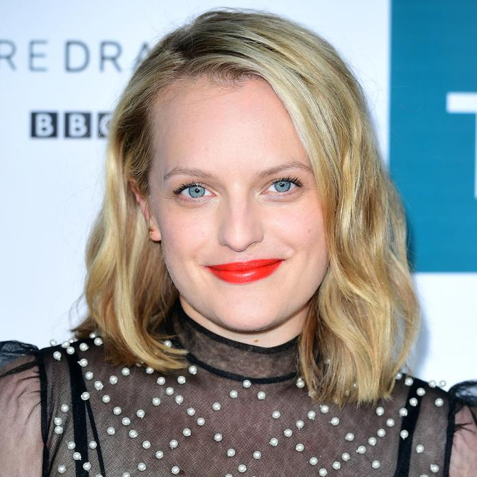 <p>The <em>Handmaid's Tale</em> star went for a statement lip at a recent<em>Top of the Lake</em>photocall, opting for a bold orange-red hue.</p>