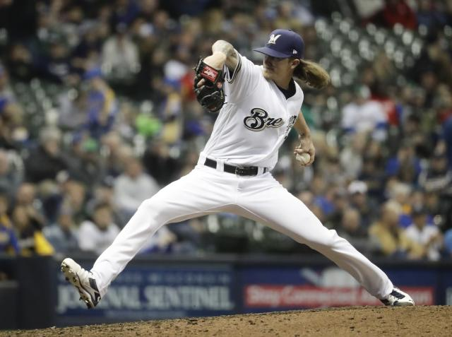 Milwaukee Brewers relief pitcher Josh Hader throws during the eighth inning of a baseball game against the Cincinnati Reds Tuesday, April 17, 2018, in Milwaukee. (AP Photo/Morry Gash)