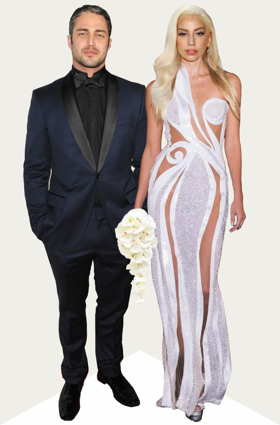 Never one to cover up, this Versace dress is strategic in its fabric placement, making it appropriate for a wedding day and fitting with Gaga's unique sense of style.