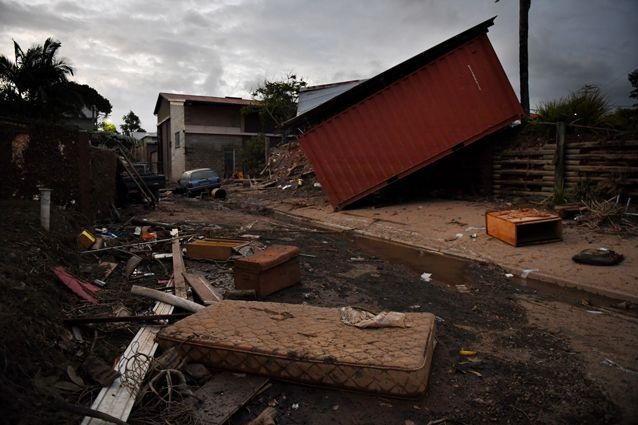 Ruined possessions and dislodged shipping containers in the streets as residents clean up after the floods in Murwillumbah, NSW. Source: AAP