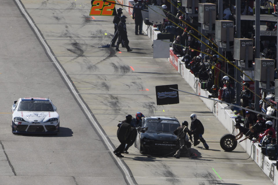 Carson Ware makes a pit stop after causing a yellow flag during a NASCAR Xfinity Series auto race, Saturday, Sept. 4, 2021, in Darlington, S.C. (AP Photo/John Amis)