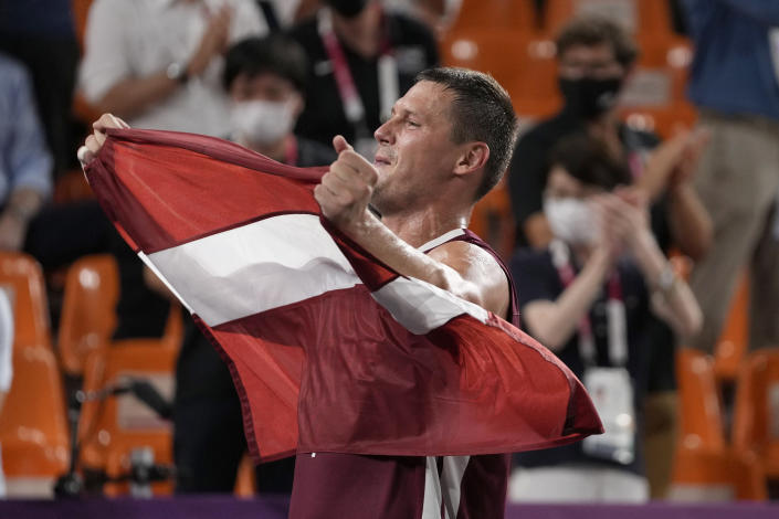 Latvia's Agnis Cavars (4) celebrates after defeating Russian Olympic Committee to win the men's 3-on-3 basketball gold medal at the 2020 Summer Olympics, Wednesday, July 28, 2021, in Tokyo, Japan. (AP Photo/Jeff Roberson)