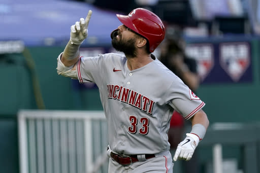 Cincinnati Reds' Jesse Winker celebrates after hitting a two-run home run against the Kansas City Royals during the third inning of the second game of baseball doubleheader Wednesday, Aug. 19, 2020, in Kansas City, Mo. (AP Photo/Charlie Riedel)