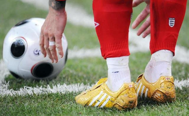 Beckham wore gold boots to commemorate his 100th England cap (Owen Humphreys/PA)