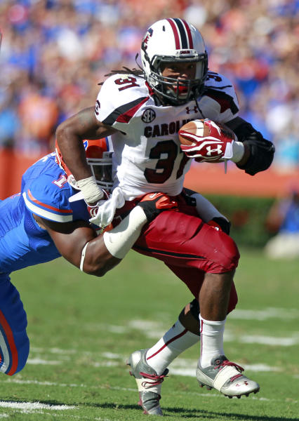 South Carolina running back Kenny Miles (31) is tackled by Florida linebacker Jon Bostic (1) after a short gain during the first half of an NCAA college football game, Saturday, Oct. 20, 2012, in Gainesville, Fla. (AP Photo/John Raoux)