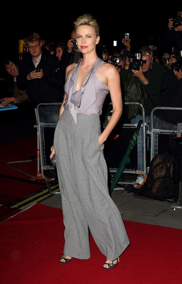 "Following in Emma's footsteps was Oscar winner Charlize Theron (""Monster""), who paired a Roland Mouret blouse with wide-leg trousers, Jimmy Choo sandals, and a chic updo. What do you make of the statuesque beauty's bold look? Hot or not? Mike Marsland/<a href=""http://www.wireimage.com"" target=""new"">WireImage.com</a> - September 6, 2011"