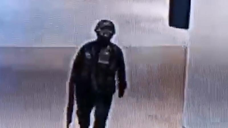 Thai police say a shooter shown in CCTV footage is still at large in a shopping mall
