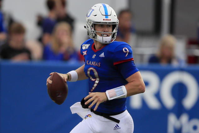Kansas quarterback Carter Stanley looks for a receiver during the first half of an NCAA college football game against West Virginia in Lawrence, Kan., Saturday, Sept. 21, 2019. (AP Photo/Orlin Wagner)