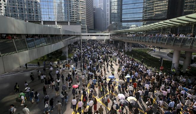 Protesters flood onto a road in Central during a lunchtime rally on Friday. Photo: David Wong