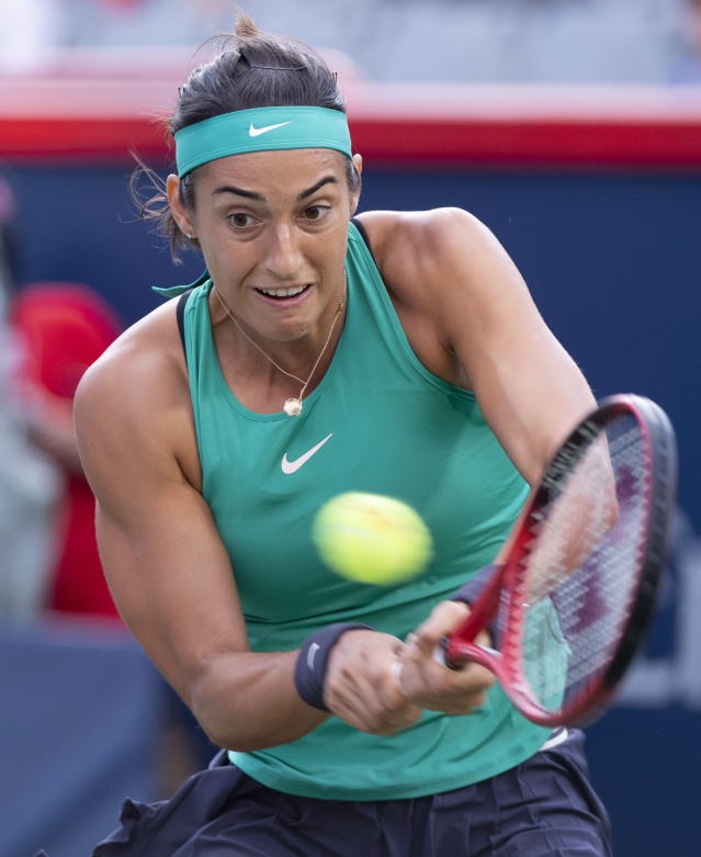 Caroline Garcia, of France, returns to Maria Sharapova, of Russia, during the Rogers Cup womens tennis tournament Thursday, Aug. 9, 2018, in Montreal. (Paul Chiasson/The Canadian Press via AP)