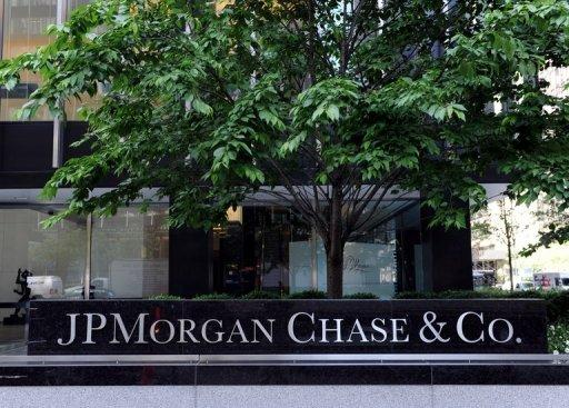 "Sign outside the JP Morgan Chase building on Park Avenue in New York. JPMorgan Chase's shares were pummeled and politicians blasted its CEO Jamie Dimon after the bank reported a shock $2 billion derivatives loss that even the pugnacious chief executive called ""egregious."""