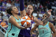 New York Liberty guard/forward Betnijah Laney (44) shoots in front of Phoenix Mercury center Brittney Griner (42) during the second half in the first round of the WNBA basketball playoffs, Thursday, Sept. 23, 2021, in Phoenix. Phoenix won 83-82. (AP Photo/Rick Scuteri)