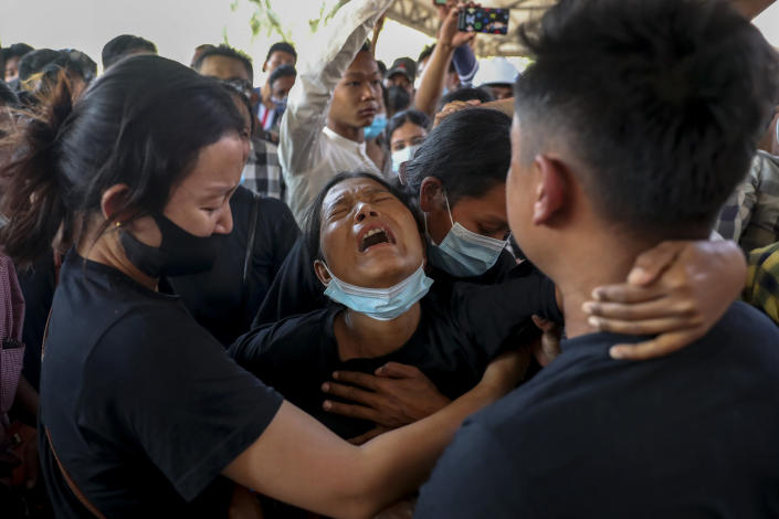 Thida Hnin cries during the funeral of her husband Thet Naing Win at Kyarnikan cemetery in Mandalay, Myanmar, Tuesday, Feb. 23, 2021. Thet Naing Win was shot and killed by Myanmar security forces during an anti-coup protest on Saturday, Feb. 20. (AP Photo)