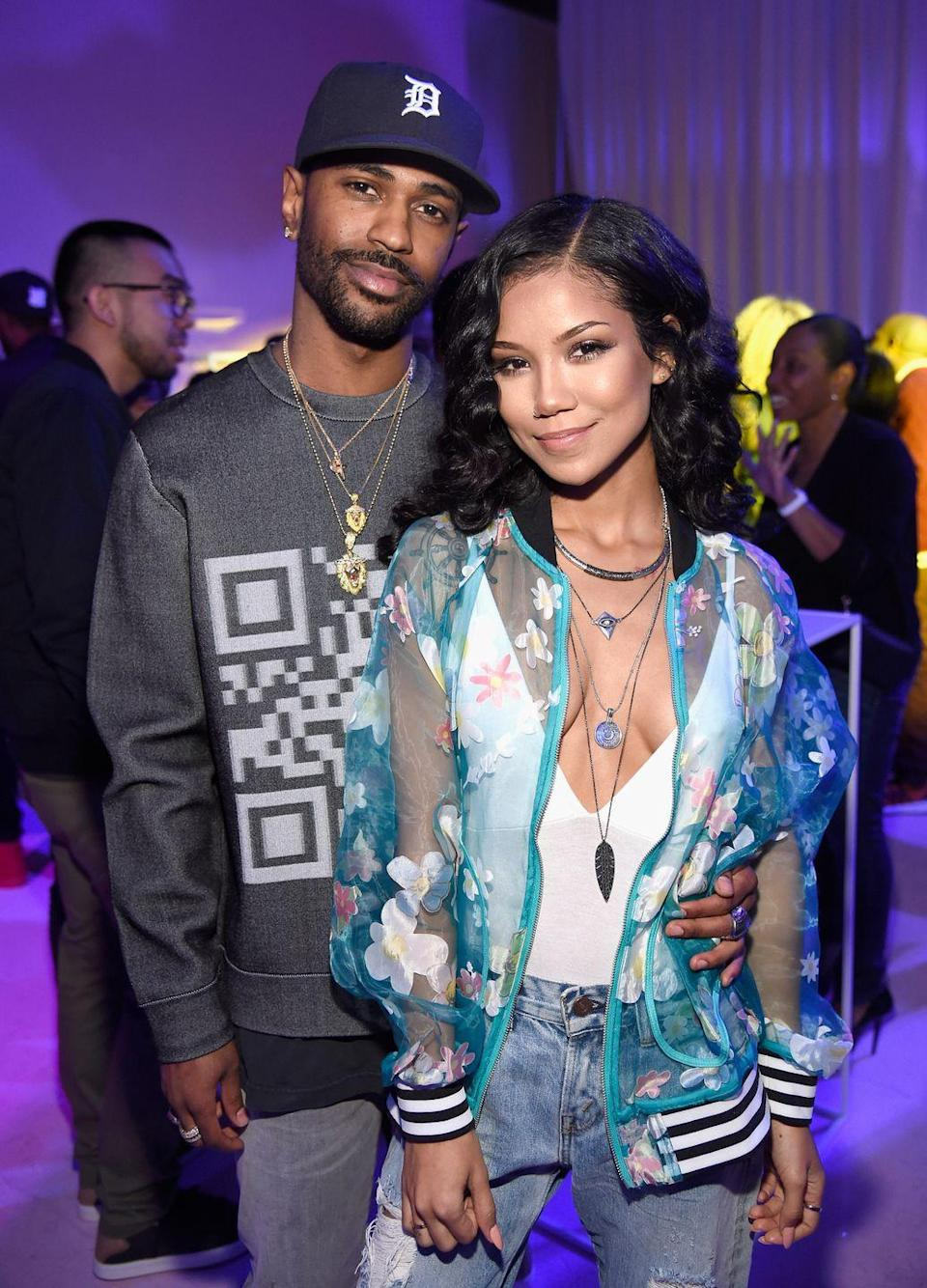 """<p>""""Her wide stance tells us she feels grounded and confident,"""" says Donaldson. As Sean holds her waist, Jhené doesn't feel the need to latch onto him in any way, Donaldson points out, because Jhené knows he's not going anywhere. He's proven over their years together that he'll always be there for her. </p>"""
