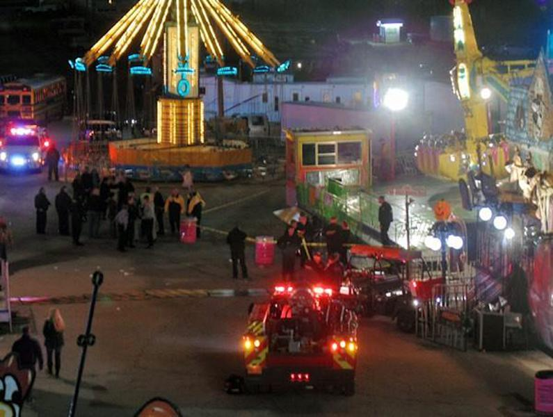 In this photo provided by WNCN, emergency crews respond to the scene where a ride malfunctioned at the North Carolina State Fair, Thursday, Oct. 24, 2013 in Raleigh, N.C. Several people were sent to the hospital with unknown injuries. (AP Photo/WNCN, Alison Blevins) MANDATORY CREDIT: WNCN