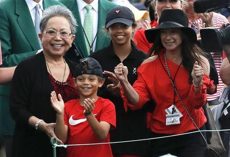 Golf - Masters - Augusta National Golf Club - Augusta, Georgia, U.S. - April 14, 2019 - Tiger Woods' family, daughter Sam Alexis, son Charlie Axel, mother Kultida woods (L) and girlfriend Erica Herman, smile has he approaches them after he won the 2019 Masters. REUTERS/Mike Segar