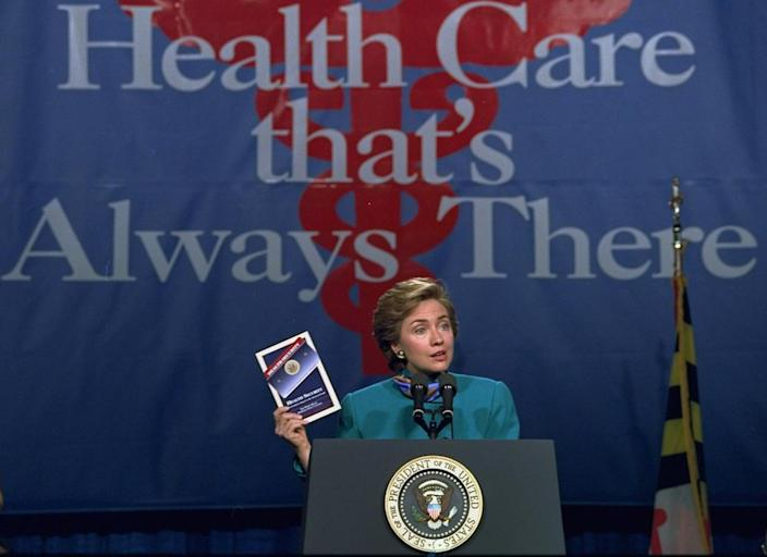 <p>First lady Hillary Rodham Clinton, holding a copy of the Clinton health care plan, kicks off a three-state campaign to promote the plan during a visit to the Johns Hopkins University in Baltimore, Md., in October 1993. (Photo: Joe Marquette/AP)</p>