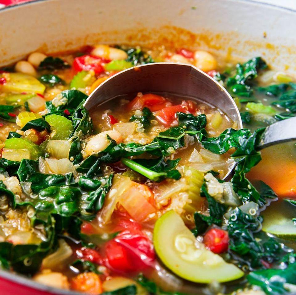 """<p>This <a href=""""https://www.delish.com/uk/cooking/recipes/g29869350/healthy-soup-recipes/"""" rel=""""nofollow noopener"""" target=""""_blank"""" data-ylk=""""slk:hearty soup"""" class=""""link rapid-noclick-resp"""">hearty soup</a> might be vegetarian, but it's super filling thanks to quinoa, white beans, kale, carrots, and celery. </p><p>Get the <a href=""""https://www.delish.com/uk/cooking/recipes/a32183592/quinoa-soup/"""" rel=""""nofollow noopener"""" target=""""_blank"""" data-ylk=""""slk:Quinoa Vegetable Soup"""" class=""""link rapid-noclick-resp"""">Quinoa Vegetable Soup</a> recipe.</p>"""