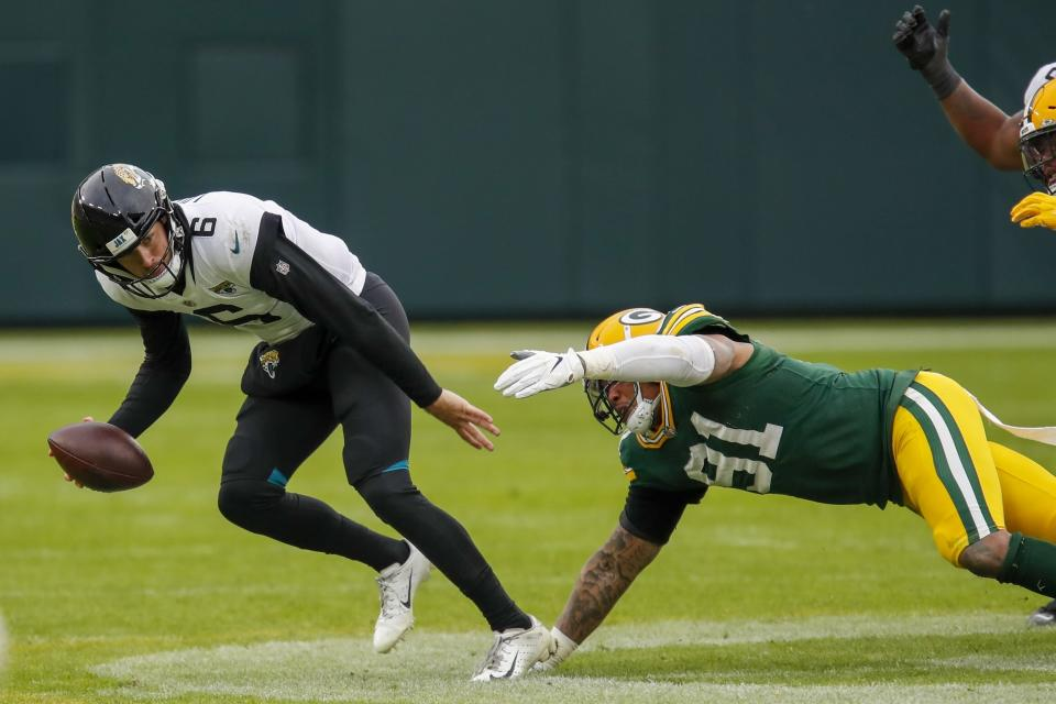 Jacksonville Jaguars' Jake Luton is sacked by Green Bay Packers' Preston Smith during the second half of an NFL football game Sunday, Nov. 15, 2020, in Green Bay, Wis. The Packers won 24-20. (AP Photo/Matt Ludtke)