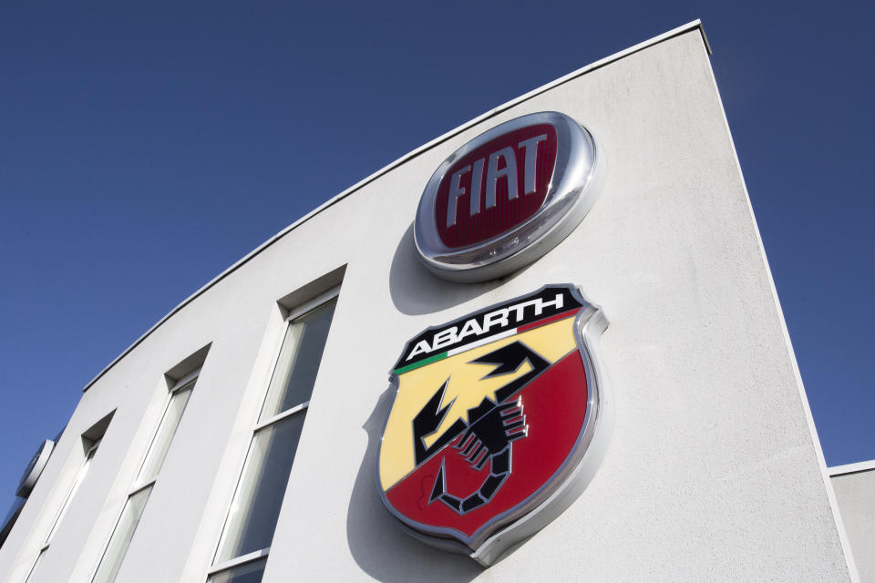 FILE - In this Nov. 2, 2019, file photo the logo of Italian automaker Fiat is pictured in Villeneuve d'Ascq, northern France. Fiat Chrysler Automobiles and PSA Peugeot are planning to announce a binding memorandum of understanding that will merge the two carmakers, a person briefed on the announcement said Monday, Dec. 16. (AP Photo/Michel Spingler, File)
