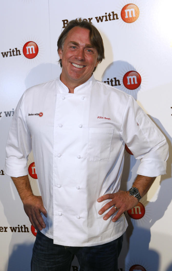 "FILE - This Jan. 31, 2013 file photo originally released by Mars Chocolate North America shows New Orleans chef John Besh at the ""Better With M"" Kick-Off Event in New Orleans. Besh invited cameras into his bayou-side home in suburban New Orleans for the filming of a new cooking show, ""Chef John Besh's Family Table."" In the new 26-part series, Besh creates family-friendly meals and gives tips on how to get the most use out of ingredients for families looking for a good value. He hopes the show will inspire families to get back in the kitchen and gathered around the supper table. The show will air in parts of the Gulf Coast region on WYES beginning April 6, and it will be distributed nationwide through American Public Television. (AP Photo/Mars Chocolate North America, Jonathan Bachman)"