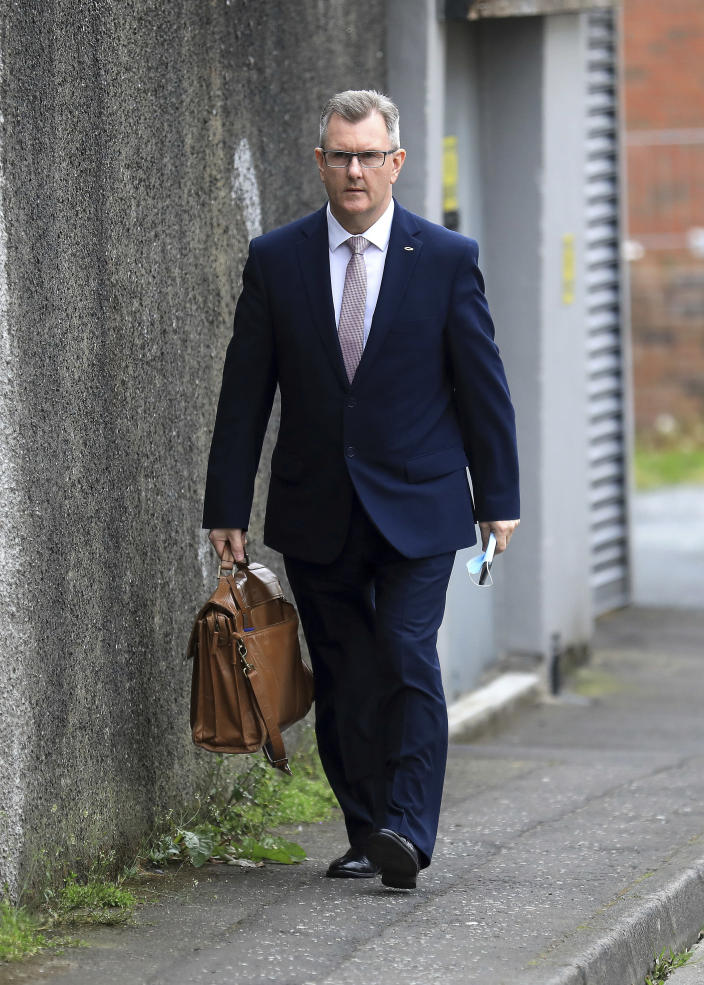Democratic Unionist Party member Jeffrey Donaldson MP leaves the party headquarters in east Belfast after voting took place to elect a new leader on Friday May 14, 2021. Edwin Poots and Jeffrey Donaldson are running to replace Arlene Foster. (AP Photo/Peter Morrison)