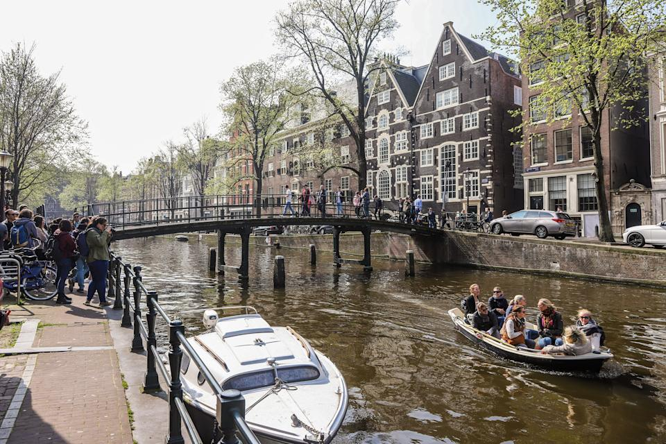 The city of Amsterdam, in the Netherlands, is trying to create an economy that can meet people's needs without causing irreparable damage to the climate and nature. Credit: Nicolas Economou/NurPhoto via Getty Images (Photo: )