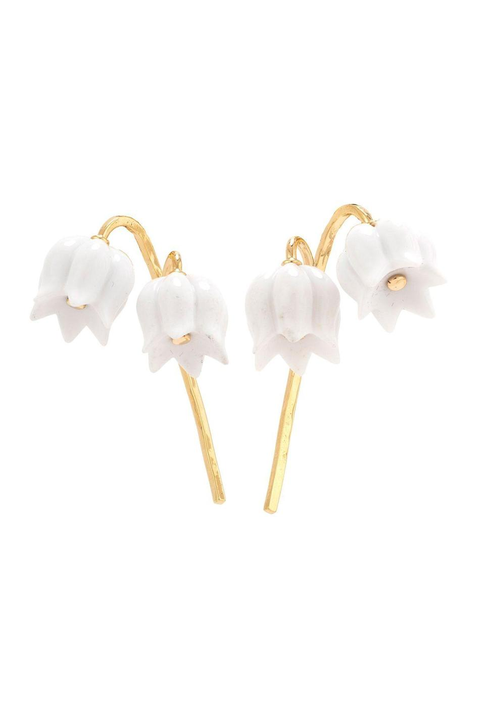 """<p><strong>Maja DuBrul</strong></p><p>majadubrul.com</p><p><strong>$5600.00</strong></p><p><a href=""""https://www.majadubrul.com/collections/earrings/products/lily-ii-small-opal-earrings"""" rel=""""nofollow noopener"""" target=""""_blank"""" data-ylk=""""slk:Shop Now"""" class=""""link rapid-noclick-resp"""">Shop Now</a></p><p>Maja DuBrul taps into her art history background to create miniature wearable works of sculpture. Here, the lily of the valley motif is rendered in white opal, which is hand-carved in Germany, and mounted on a solid hammered gold stem. And while the beloved flowers are as famous for their beauty and scent as they are for their ephemerality, these earrings will last forever.</p>"""
