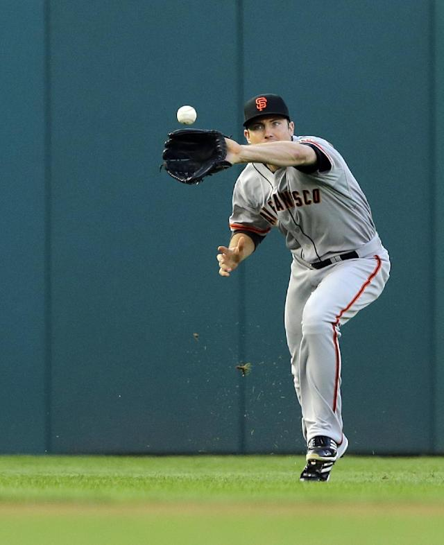 San Francisco Giants left fielder Roger Kieschnick (22) catches a fly ball hit by Washington Nationals' Denard Span during the first inning of a baseball game at Nationals Park Wednesday, Aug. 14, 2013, in Washington. (AP Photo/Alex Brandon)