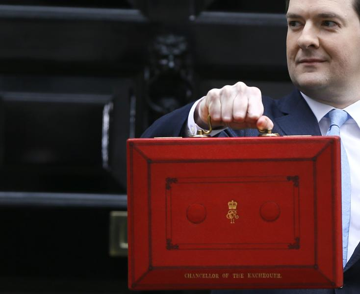 Britain's Chancellor of the Exchequer George Osborne holds up his brief case as he poses for the media before leaving Downing Street to attend Parliament in London, Wednesday, March 20, 2013. Later Wednesday Britain's Chancellor George Osborne will deliver the Spring Budget Statement in Parliament. (AP Photo/Kirsty Wigglesworth)