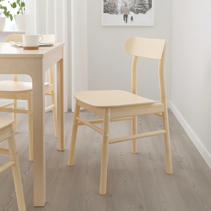 """<h3><strong>Ikea</strong></h3> <br><br><strong>Best For: Affordable Furniture<br></strong>Ah, Scandinavian minimalism. Nothing compares to that sparse, clean decor — and that super-minimal Ikea price tag. Good old Ikea has been a mainstay in our decorating journeys, from that first tiny apartment to...that fourth tiny apartment. And hey, if you're not into the """"all-white kitchen bathed in the cold Stockholm sunshine"""" look, don't worry. Ikea is <a href=""""https://www.refinery29.com/en-us/2017/01/138025/ikea-new-collections"""" rel=""""nofollow noopener"""" target=""""_blank"""" data-ylk=""""slk:full of surprises"""" class=""""link rapid-noclick-resp"""">full of surprises</a>.<br><br><strong><em><a href=""""http://www.ikea.com/"""" rel=""""nofollow noopener"""" target=""""_blank"""" data-ylk=""""slk:Shop Ikea"""" class=""""link rapid-noclick-resp"""">Shop Ikea</a></em></strong><br><br><strong>Ikea</strong> RÖNNINGE Chair, $, available at <a href=""""https://go.skimresources.com/?id=30283X879131&url=https%3A%2F%2Fwww.ikea.com%2Fus%2Fen%2Fp%2Froenninge-chair-birch-10422504%2F"""" rel=""""nofollow noopener"""" target=""""_blank"""" data-ylk=""""slk:Ikea"""" class=""""link rapid-noclick-resp"""">Ikea</a><br><br><br><br>"""