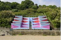 """<p>""""No. 1054 Arpeggio is Rana Begum's largest artwork to date, and since it transforms 120 beach huts on an 800-metre stretch of seafront, it must be one of the largest and most ambitious in the country. It is also extremely joyful, with an insistent rhythm to its design and colours that makes it the quintessential seaside art experience.""""</p>"""