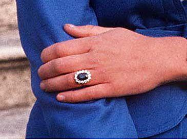"""<p>Charles presented Diana with this <a href=""""https://www.townandcountrymag.com/style/jewelry-and-watches/g13060157/famous-royal-engagement-rings/?slide=4"""" rel=""""nofollow noopener"""" target=""""_blank"""" data-ylk=""""slk:jaw-dropping engagement ring"""" class=""""link rapid-noclick-resp"""">jaw-dropping engagement ring</a>, made from a 12-carat oval blue Ceylon sapphire, surrounded by 14 solitaire diamonds and set in 18-karat white gold. The ring, created by British jeweler Garrard, <a href=""""https://www.townandcountrymag.com/style/jewelry-and-watches/a13052347/kate-middleton-engagement-ring/"""" rel=""""nofollow noopener"""" target=""""_blank"""" data-ylk=""""slk:now belongs to Catherine"""" class=""""link rapid-noclick-resp"""">now belongs to Catherine</a>, Duchess of Cambridge. </p>"""