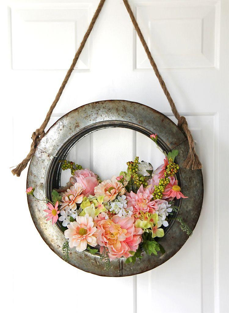 """<p>It doesn't get much more farmhouse-friendly than tire wall art-turned-wreath filled with dainty pastel blooms. The color contrast ups the cool factor, as well. </p><p><strong>Get the tutorial at <a href=""""https://www.thecraftpatchblog.com/farmhouse-style-diy-spring-wreath/"""" rel=""""nofollow noopener"""" target=""""_blank"""" data-ylk=""""slk:The Craft Patch"""" class=""""link rapid-noclick-resp"""">The Craft Patch</a>. </strong></p><p><strong><a class=""""link rapid-noclick-resp"""" href=""""https://www.amazon.com/Galvanized-Create-Farmhouse-Wreaths-Florals/dp/B077LX95M2/?tag=syn-yahoo-20&ascsubtag=%5Bartid%7C10050.g.4088%5Bsrc%7Cyahoo-us"""" rel=""""nofollow noopener"""" target=""""_blank"""" data-ylk=""""slk:SHOP TIRE SWINGS"""">SHOP TIRE SWINGS</a><br></strong></p>"""