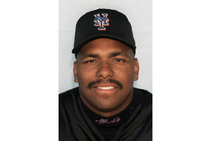 FILE - This is a 1999 file photo showing Bobby Bonilla of the New York Mets baseball team. The New York Mets under new owner Steven Cohen are embracing Bobby Bonilla Day, an annual remembrance of a famously unsuccessful contract. A promotion announced Thursday, July 1, 2021, that allows a fan to book an Airbnb stay for four at Citi Field for $250 that includes use of the team gym and shower. The promotion includes throwing out the ceremonial first pitch before the Mets play Atlanta on July 28. (AP Photo/File)