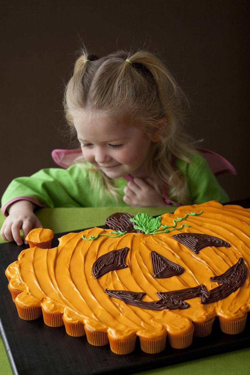 """<p>There's nothing more classically Halloween than a pumpkin, so why not create a giant pumpkin cake out of dozens of cupcakes?</p><p><em><a href=""""https://www.womansday.com/food-recipes/food-drinks/recipes/a11046/pumpkin-patch-pull-apart-recipe-122474/"""" rel=""""nofollow noopener"""" target=""""_blank"""" data-ylk=""""slk:Get the recipe for Pumpkin Patch Pull-Apart Cake."""" class=""""link rapid-noclick-resp"""">Get the recipe for Pumpkin Patch Pull-Apart Cake.</a>.</em></p>"""