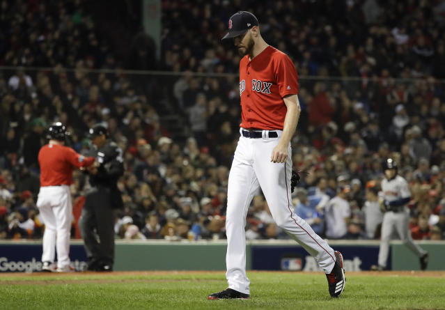 Boston Red Sox starting pitcher Chris Sale walks to the dugout after giving up two runs against the Houston Astros during the second inning in Game 1 of a baseball American League Championship Series on Saturday, Oct. 13, 2018, in Boston. (AP Photo/David J. Phillip)