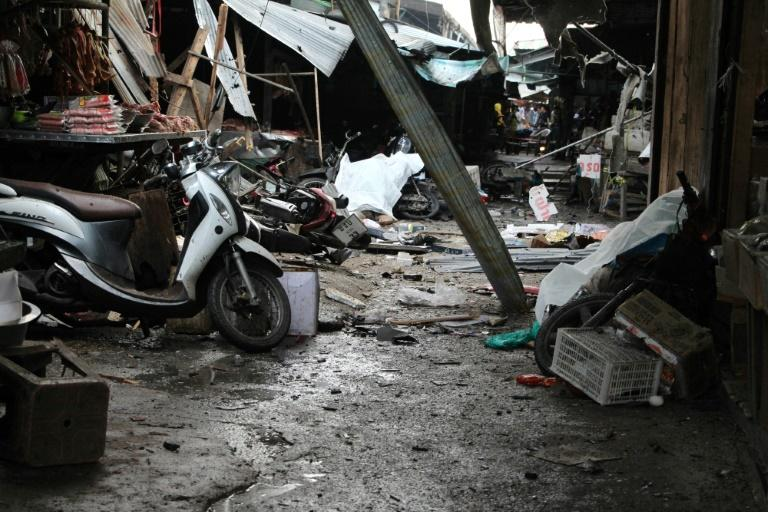 Victims killed by a motorcycle bomb lie covered amongst the wreckage left in the aftermath at a market in the southern Thai town of Yala on January 22, 2018