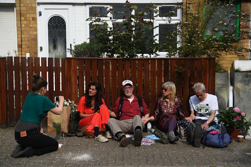 Two men and two women from the Extinction Rebellion group have glued themselves to a fence outside Jeremy Corbyn's house (PA)