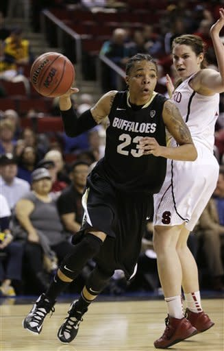 Colorado's Chucky Jeffery (23) drives past Stanford's Sara James in the first half of an NCAA college basketball game in the Pac-12 Conference tournament Saturday, March 9, 2013, in Seattle. (AP Photo/Elaine Thompson)