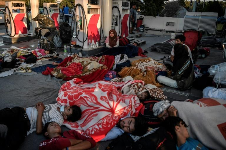 The Moria blaze sparked a chaotic exodus from the camp, with 12,000 migrants forced to sleep rough for days and sparking anger of local residents (AFP/LOUISA GOULIAMAKI)